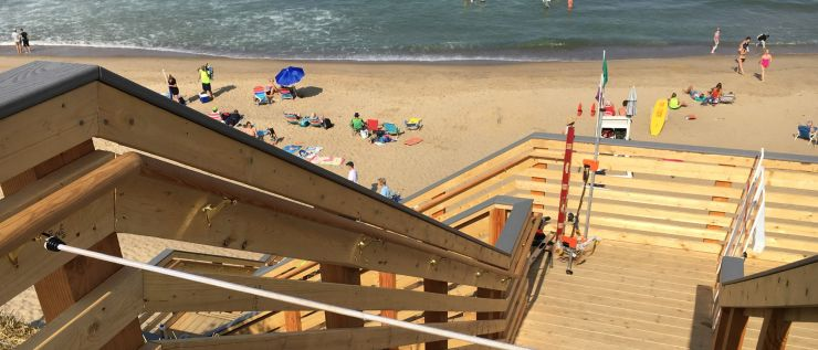 Beach with wooden boardwalk stairs